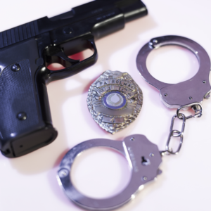 Office handgun, badge and handcuffs