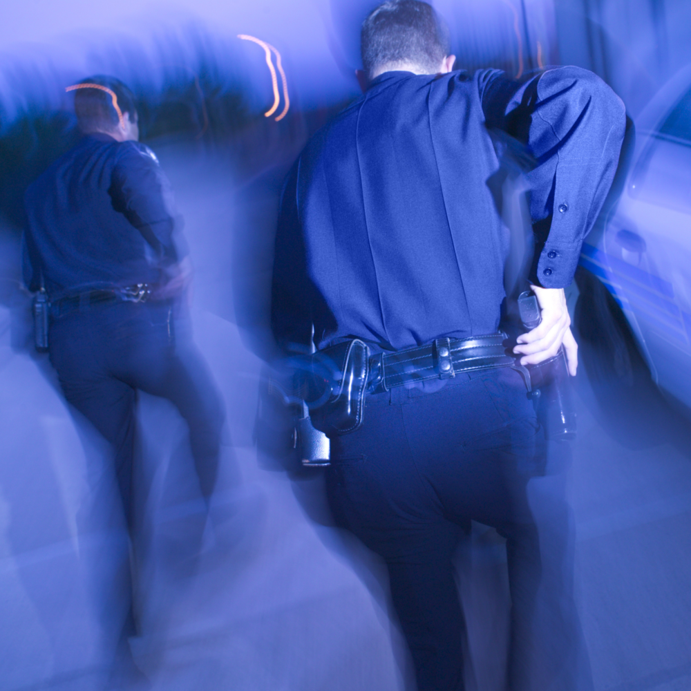 Two officers approaching with safety in mind